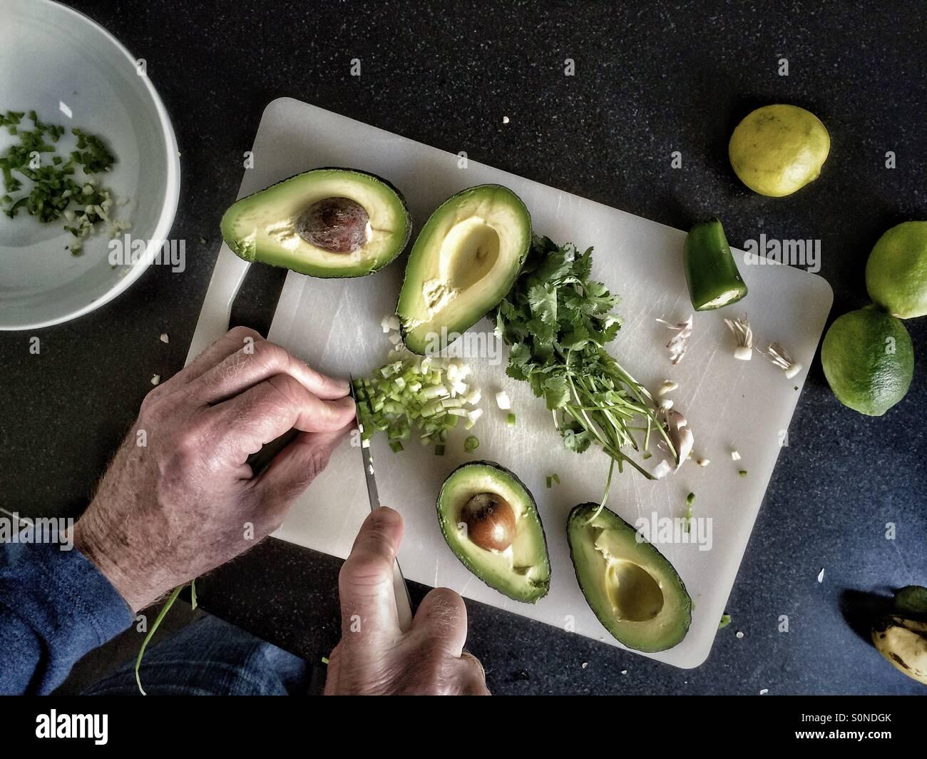 Man making guacamole Photo Stock