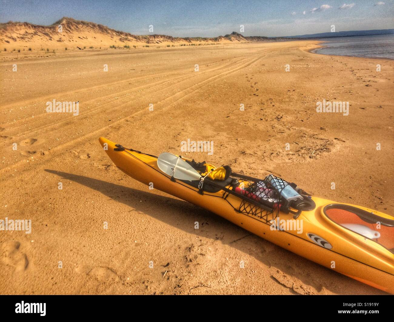 Kodiak Prijon Kayak sur une plage de sable Banque D'Images