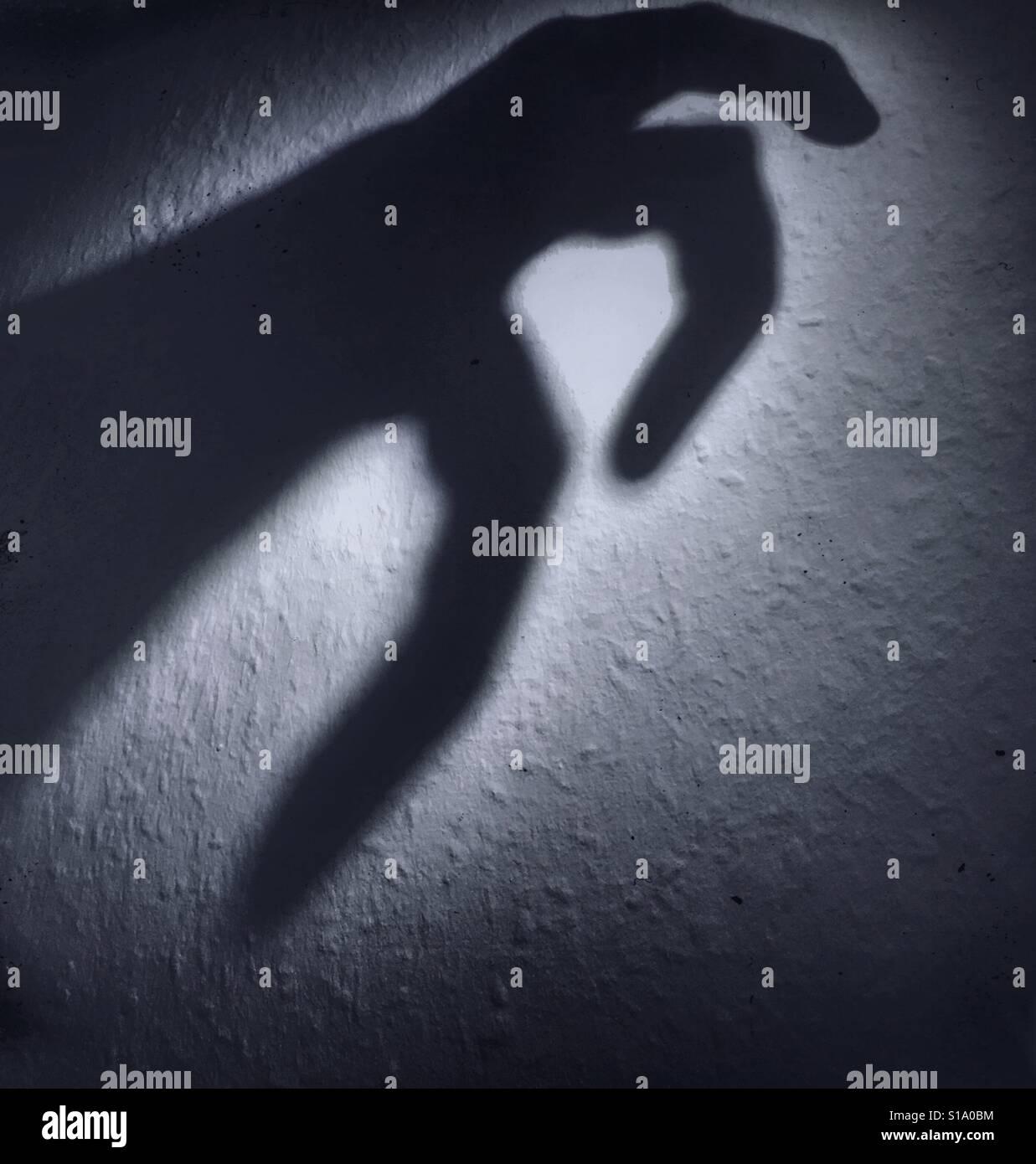 D'une main d'ombre effrayant Photo Stock