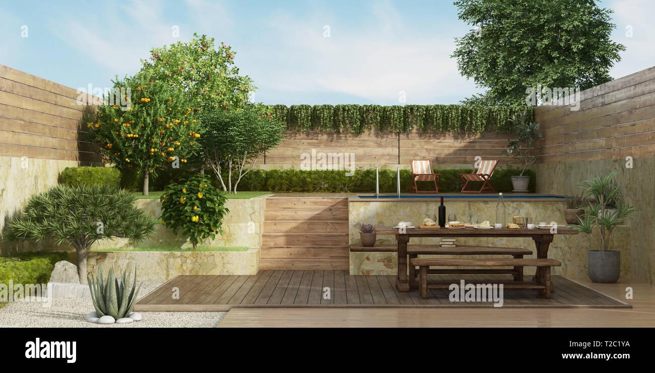 Jardin sur deux niveaux avec l\'ancienne dininig table, banc ...