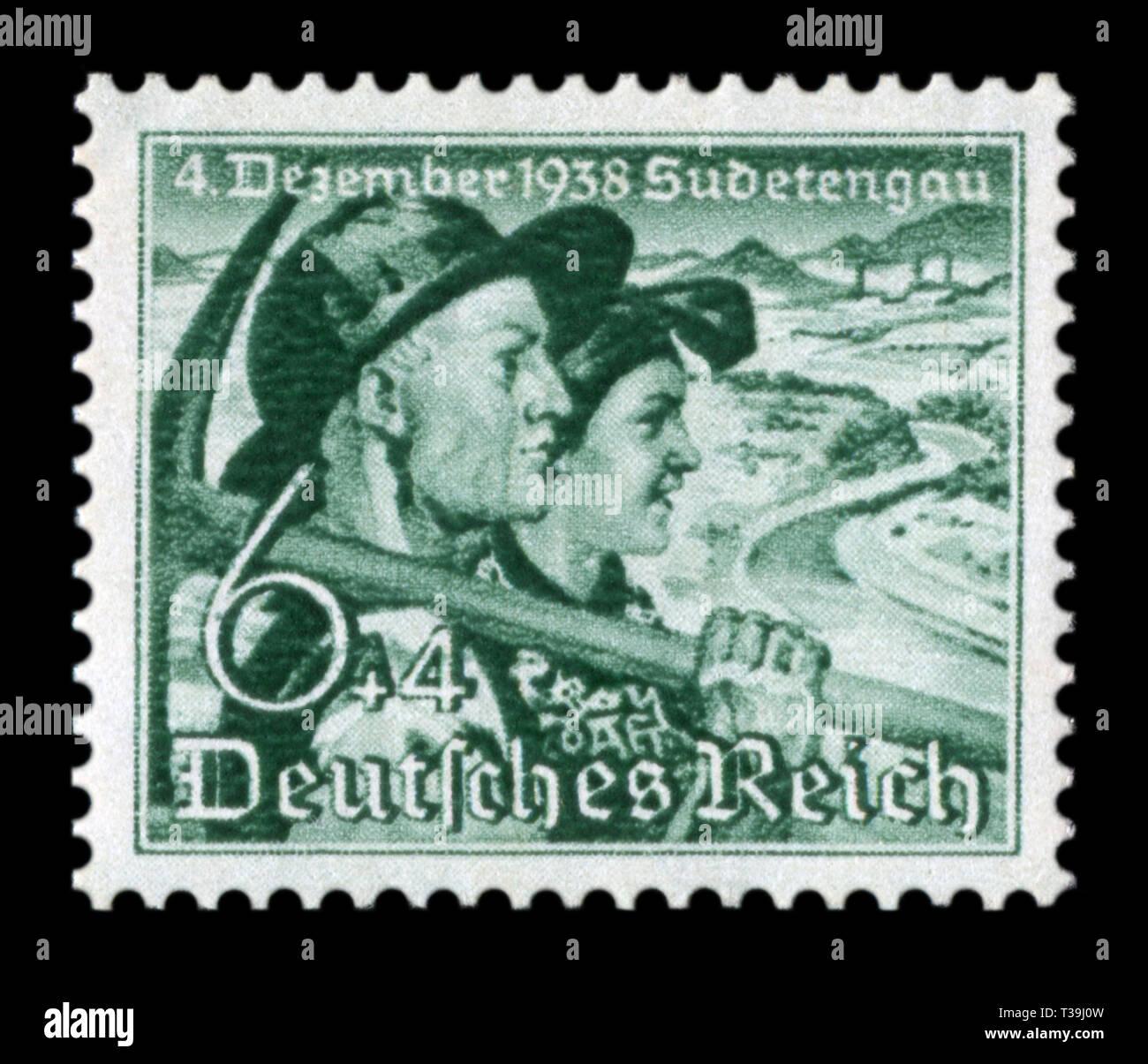 Historique allemand stamp: Référendum sur l'adhésion de la région des Sudètes. Couple. Avec un mineur et une femme paysan, 12+8 pf, numéro 1938, Allemagne Banque D'Images