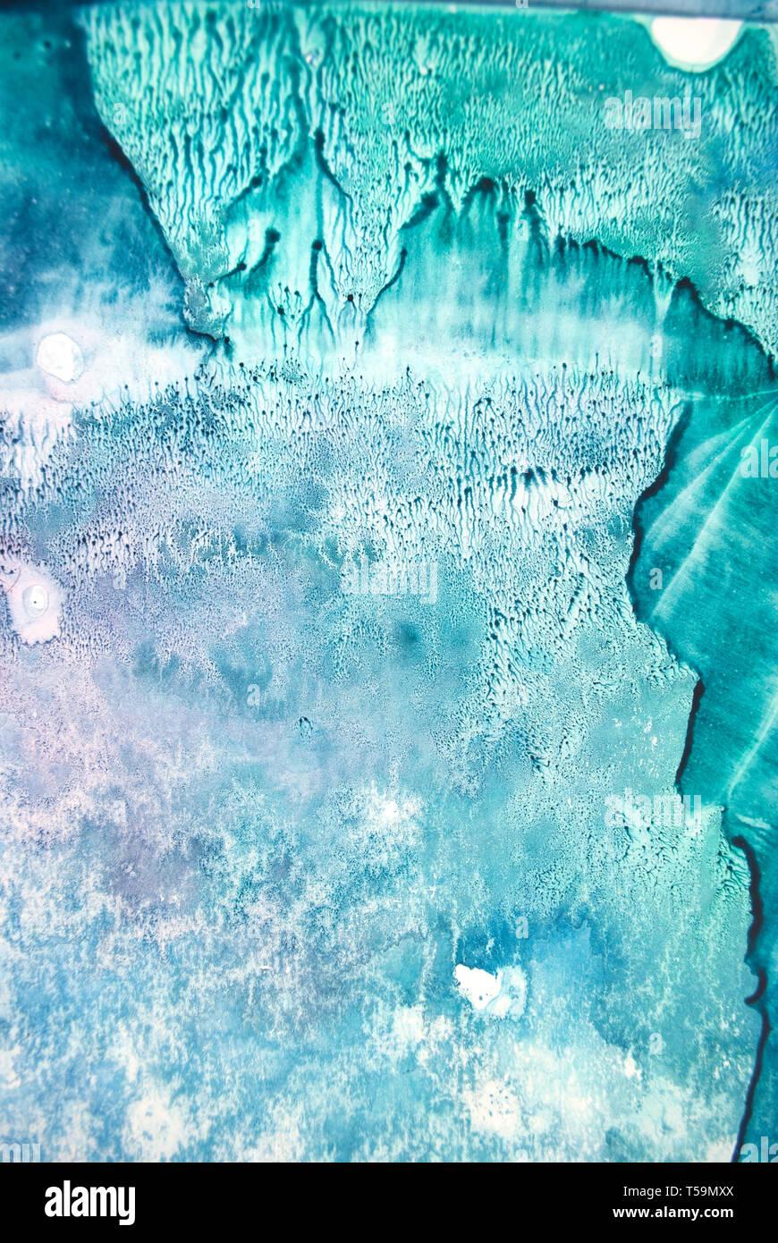 La texture aquarelle éclaboussures. Résumé d'origine, le papier, la pierre, la glace, l'espace, galaxie, la lumière cosmique les taches de couleur turquoise style blob Banque D'Images