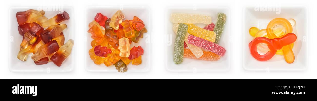 Collection de différents bonbons aux fruits de la gomme dans des bols en vue supérieure Banque D'Images