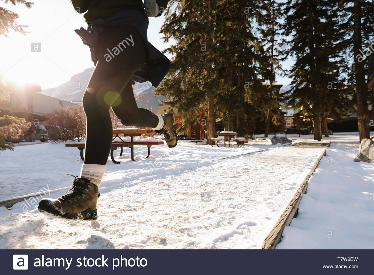 Woman running in snow Photo Stock