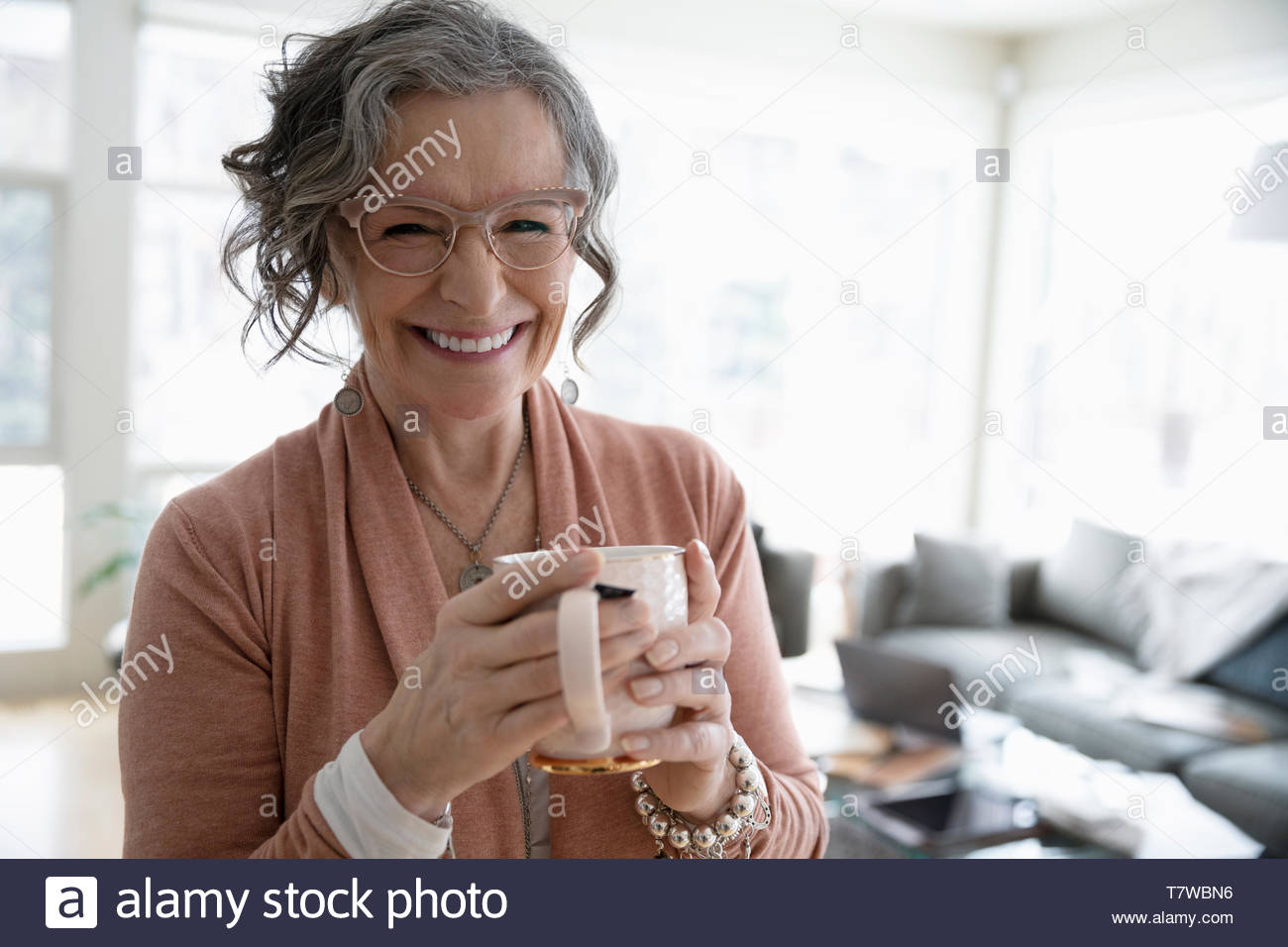 Portrait of happy woman drinking coffee Photo Stock
