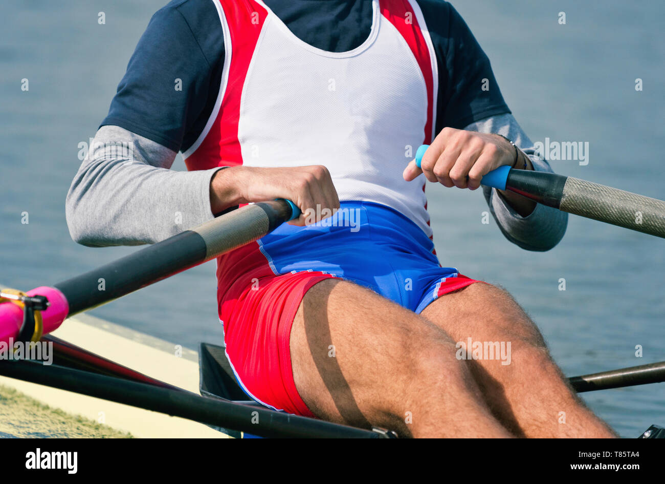 Man rowing scull Banque D'Images