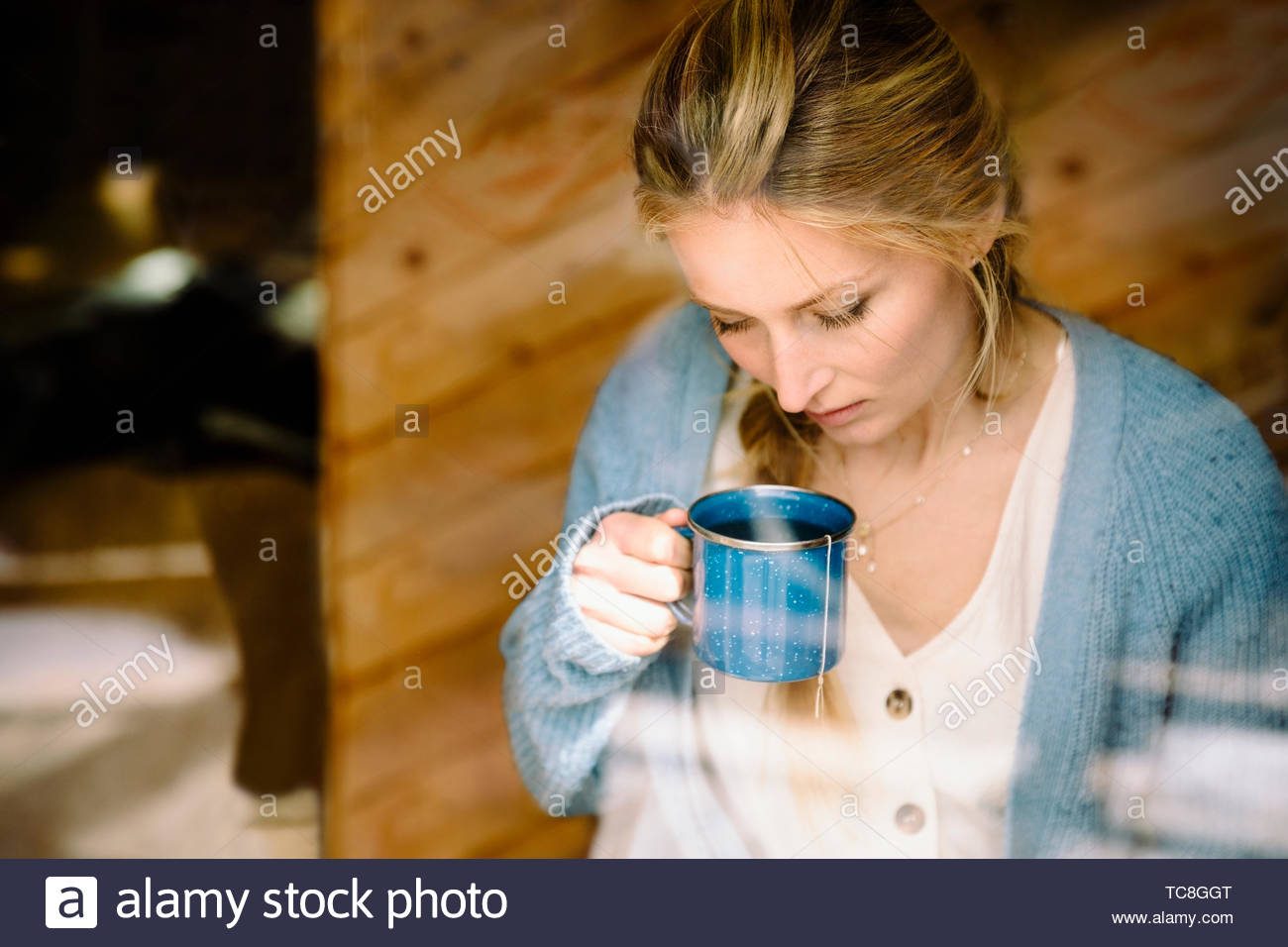 Serene woman drinking tea Photo Stock