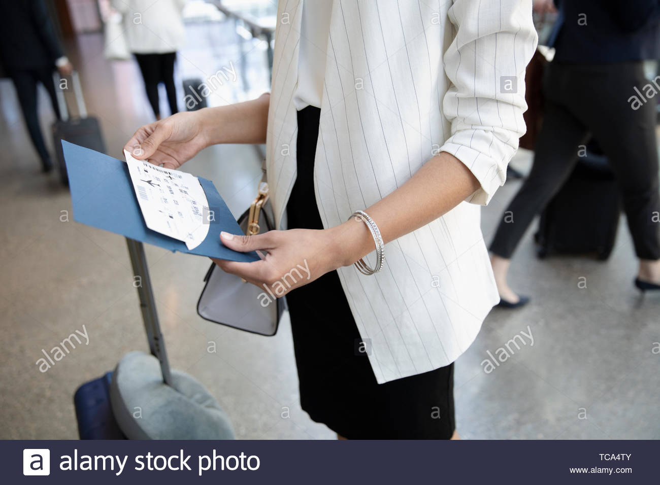 Businesswoman with airplane ticket in airport Photo Stock