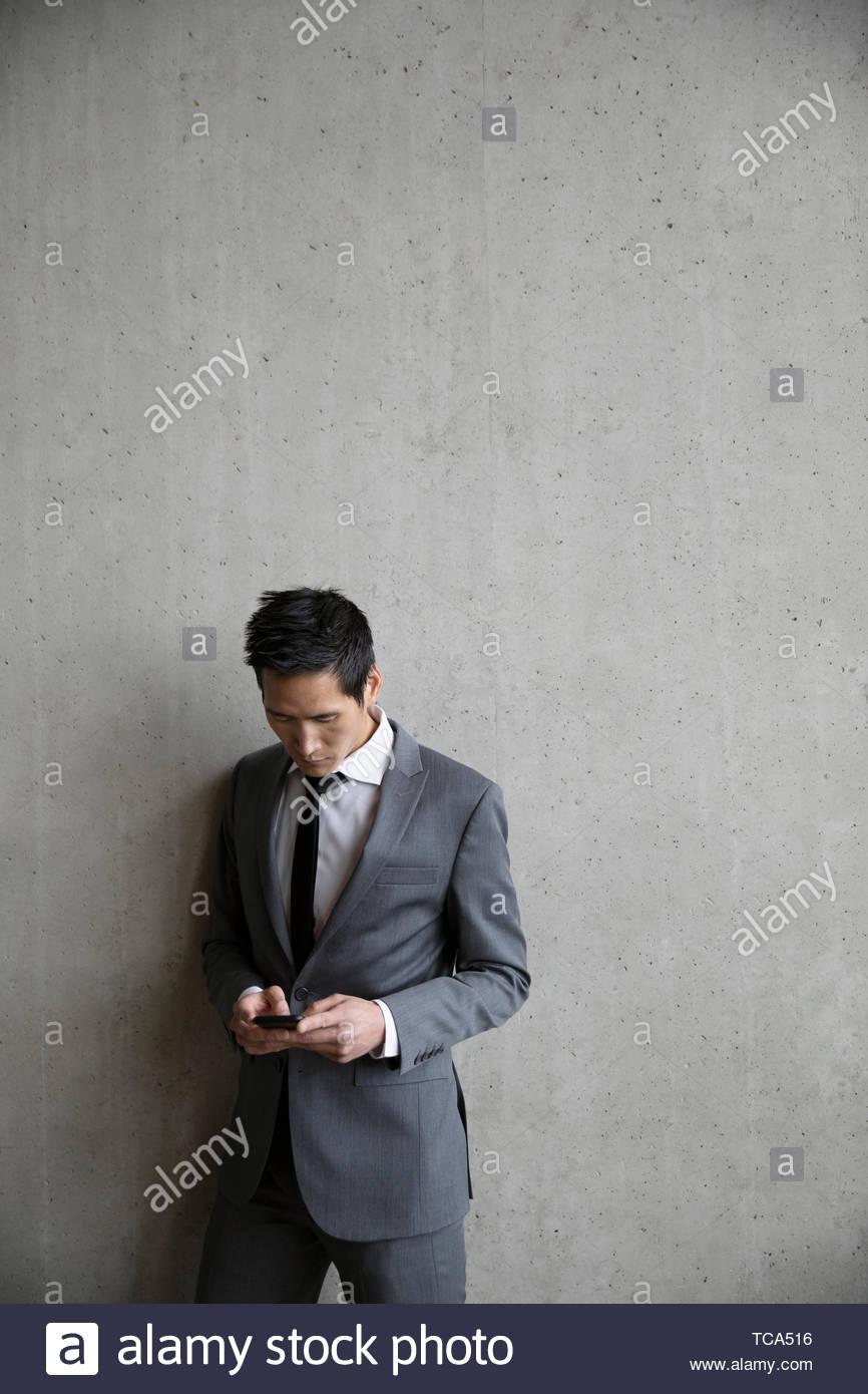 Businessman using smart phone Photo Stock
