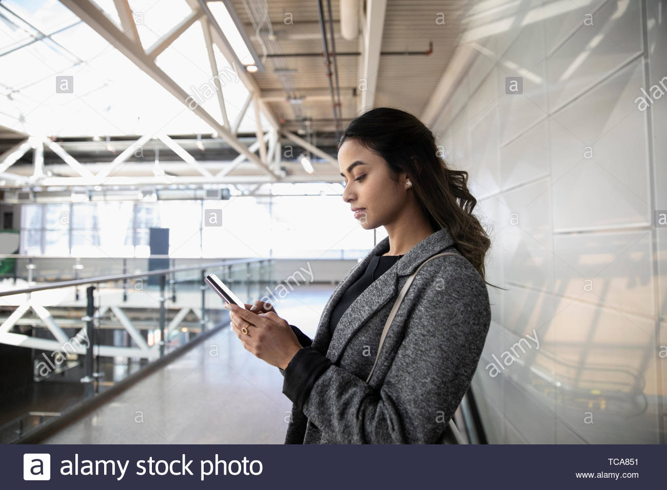 Young businesswoman using smart phone Photo Stock