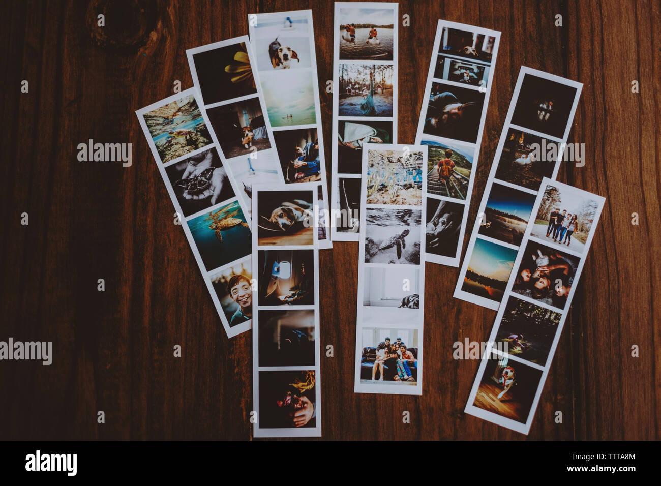 Portrait de photographies sur table en bois Photo Stock
