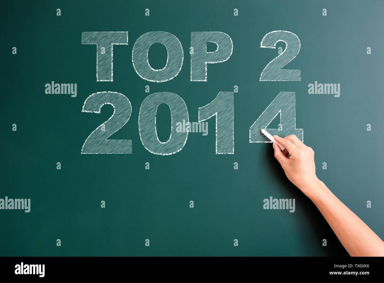 Top 2 2014 written on blackboard Photo Stock