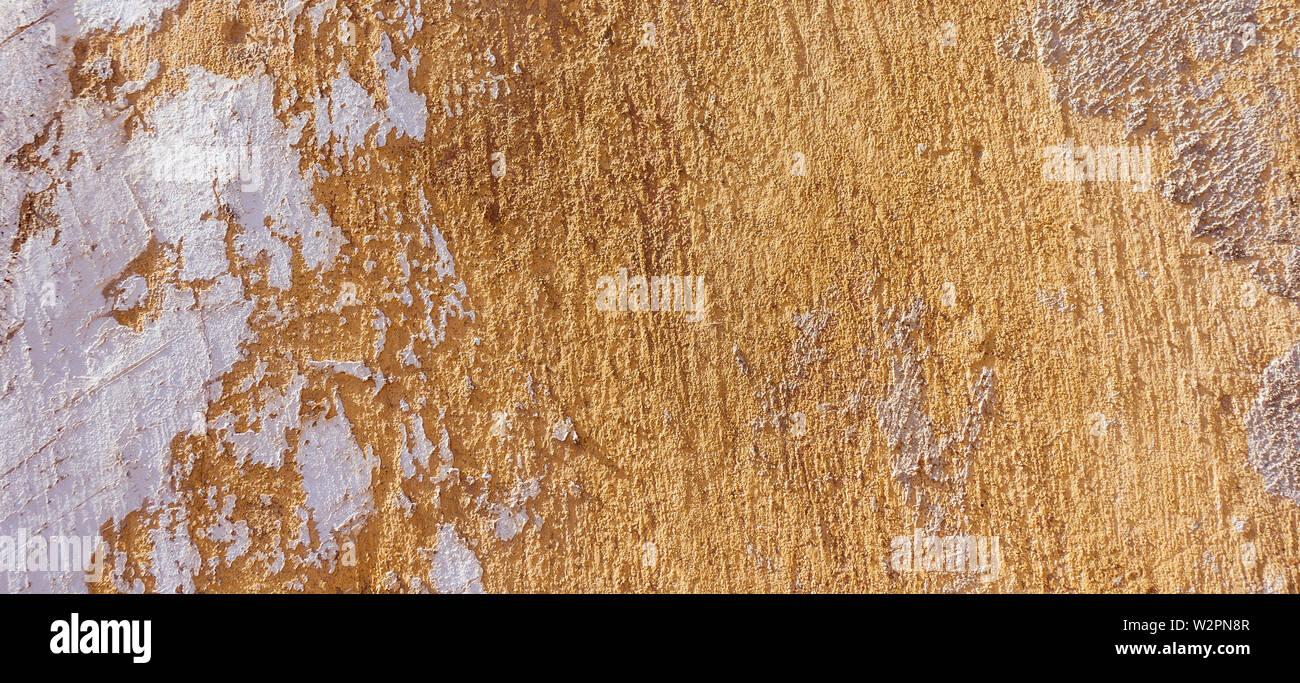 Old Weathered fissurée Plâtre Mur miteux pelé. Banque D'Images