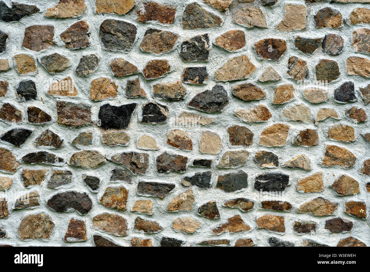 Texture de fond de mur de pierre, Close up. Façade en pierre naturelle, texture carreaux de mur Photo Stock