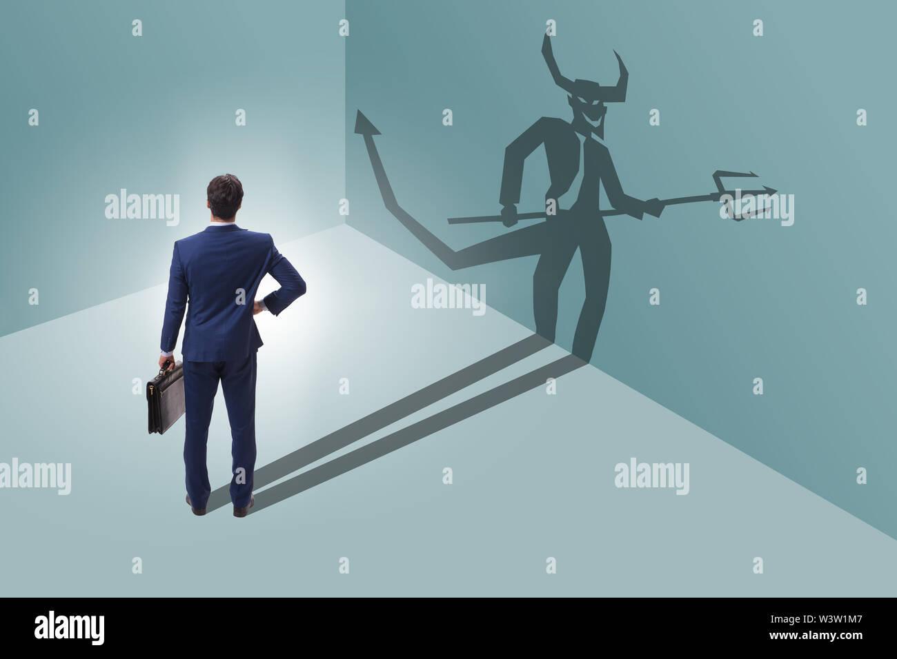 Le diable se cache dans l'homme d'affaires - concept de l'alter ego Photo Stock
