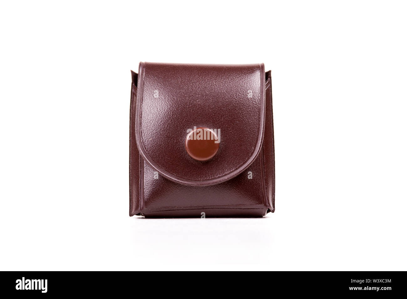 Petite poche en cuir de style vintage mini cas pour une montre, bague ou une loupe, isolé. Récipient élégant pour les petits articles de valeur concept Photo Stock