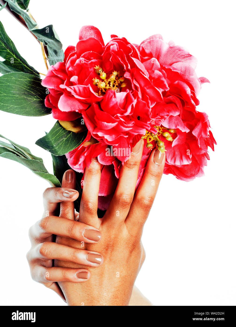 Manucure pédicure personnes concept mains, doigts femme en forme de coeur la tenue des fleurs roses isolated Photo Stock