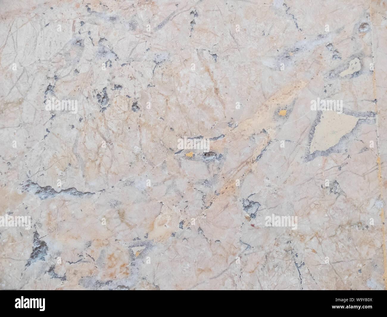Jaune, orange et gris en texture. Arrière-plan de pierre modèle homogène. Banque D'Images