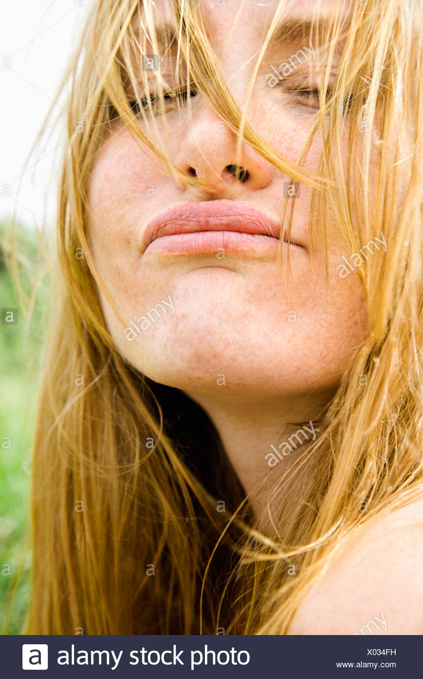 Close up portrait of attractive redheaded woman making a funny face Photo Stock