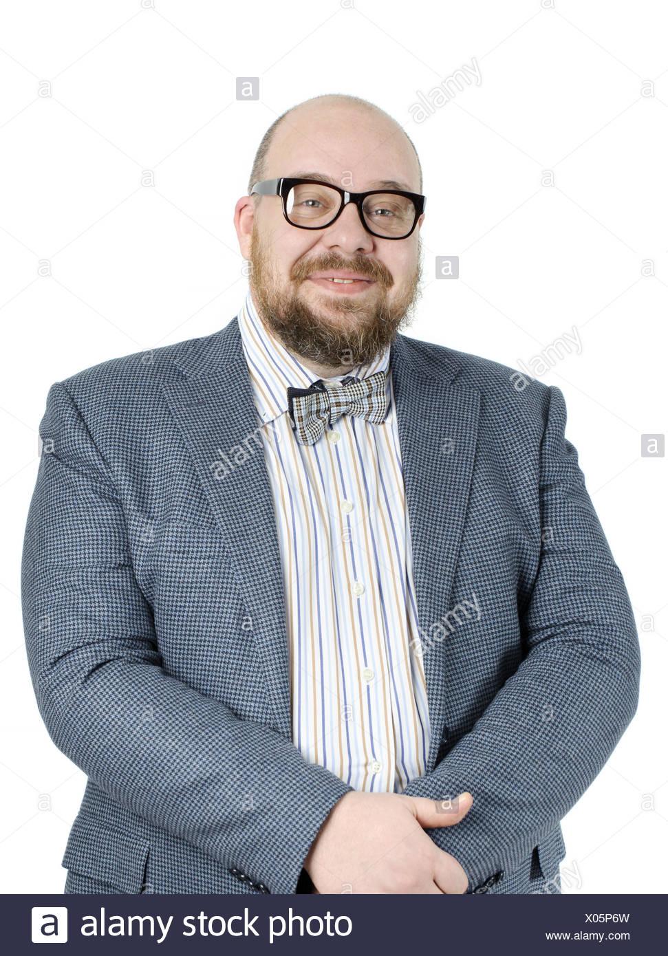 Homme barbu souriant dans une veste. Photo Stock
