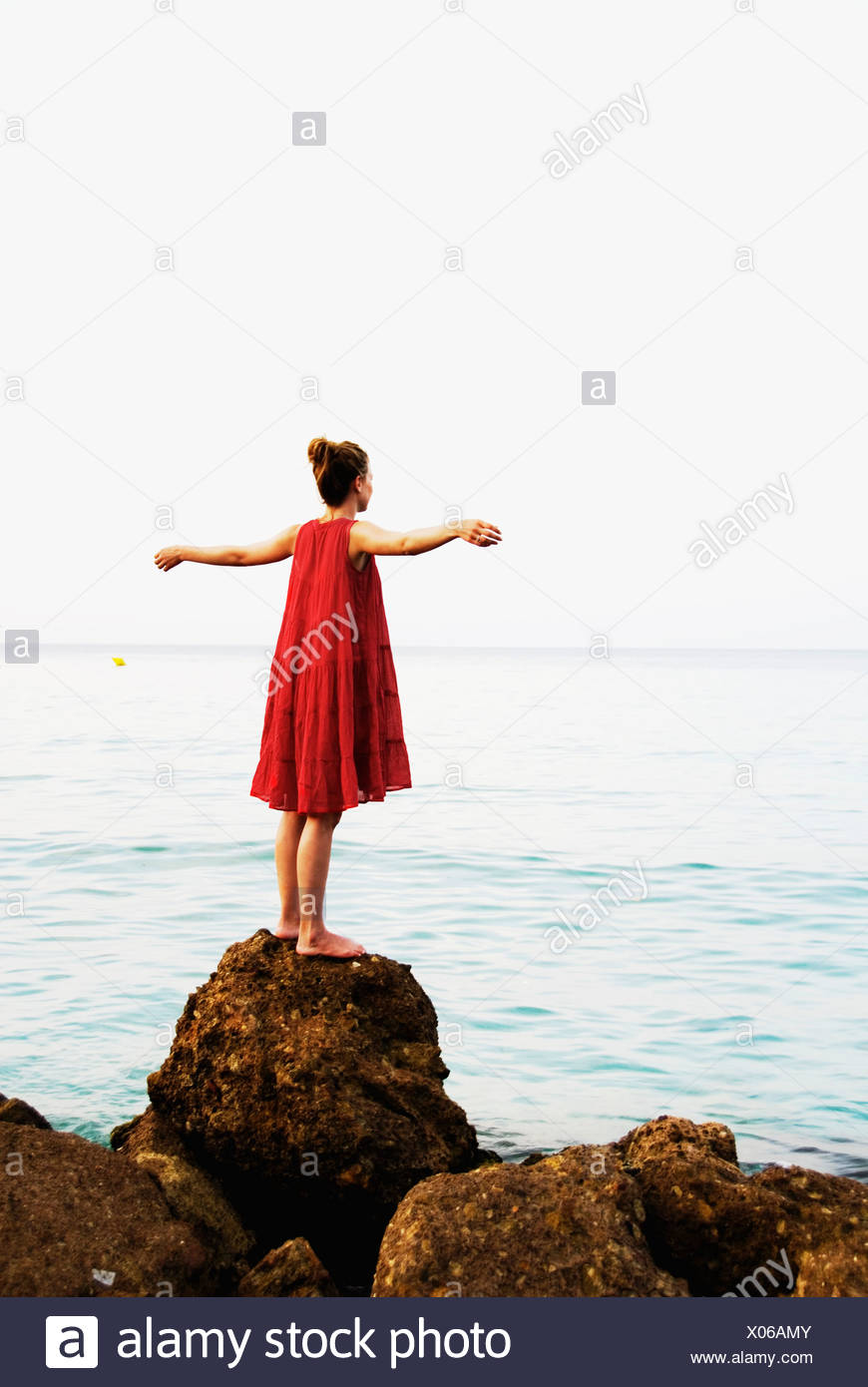 Femme en robe rouge Photo Stock