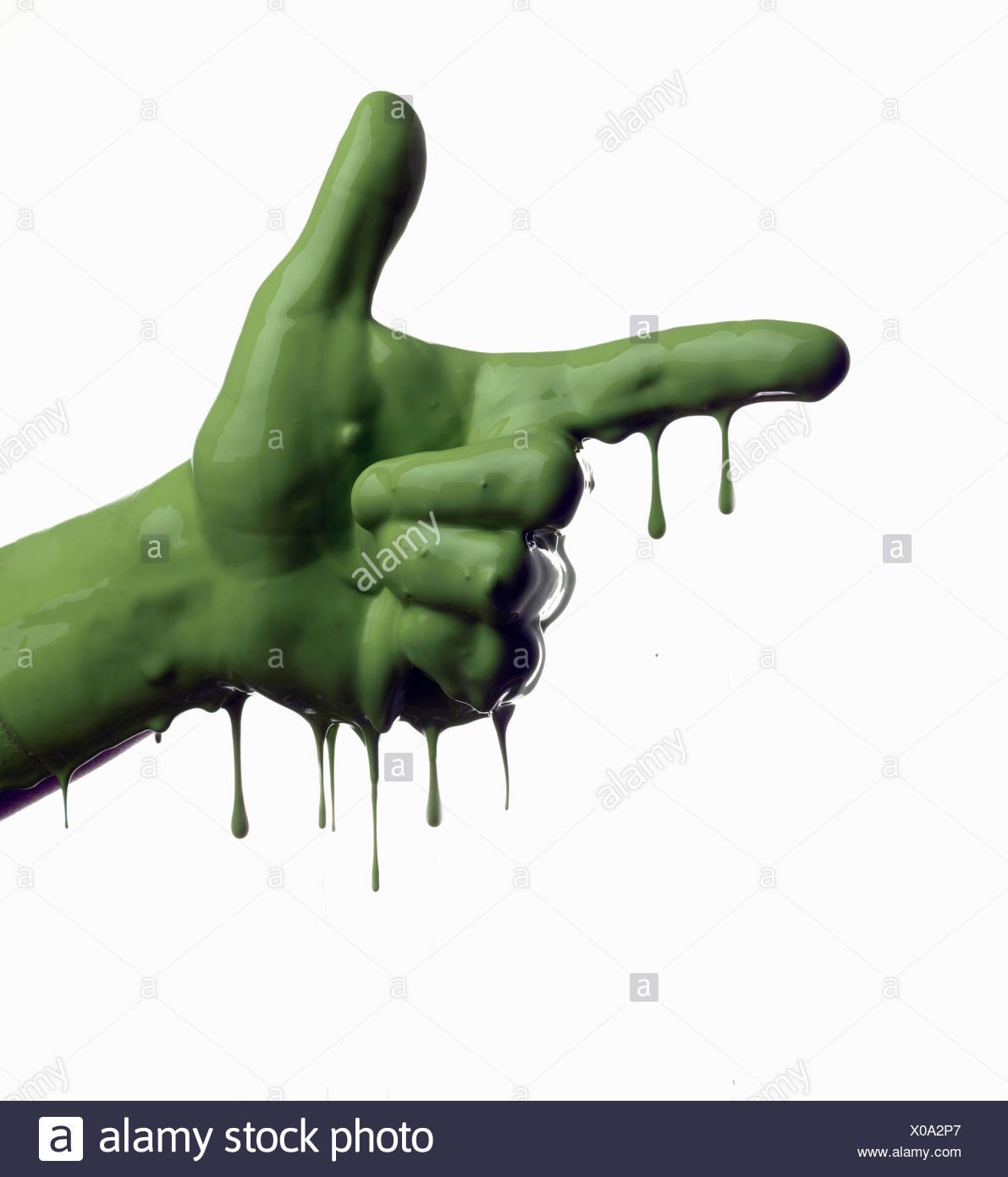 Main pointant peint en vert Photo Stock