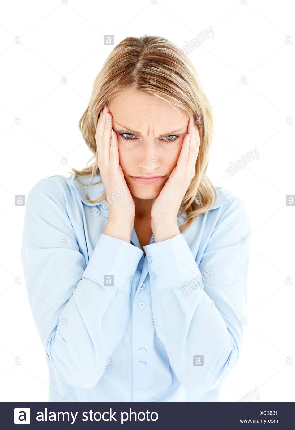 En tenant sa tête baissés businesswoman entre ses mains Photo Stock