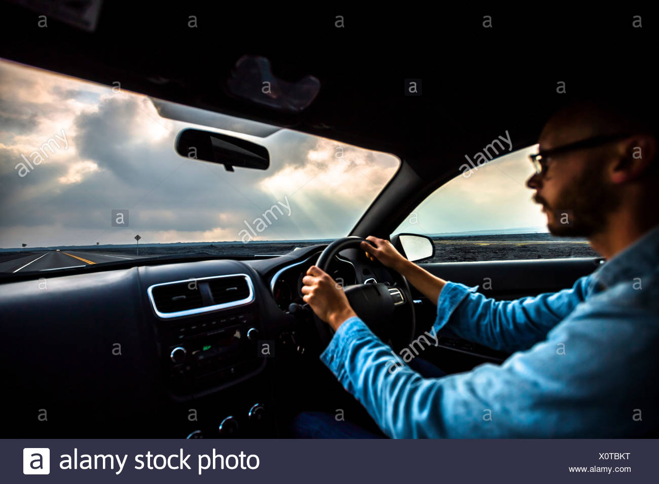 Mid adult man driving car Photo Stock