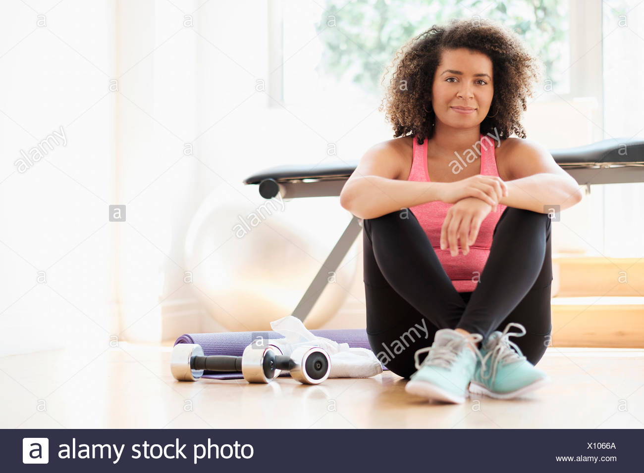 Portrait of young woman at gym Photo Stock