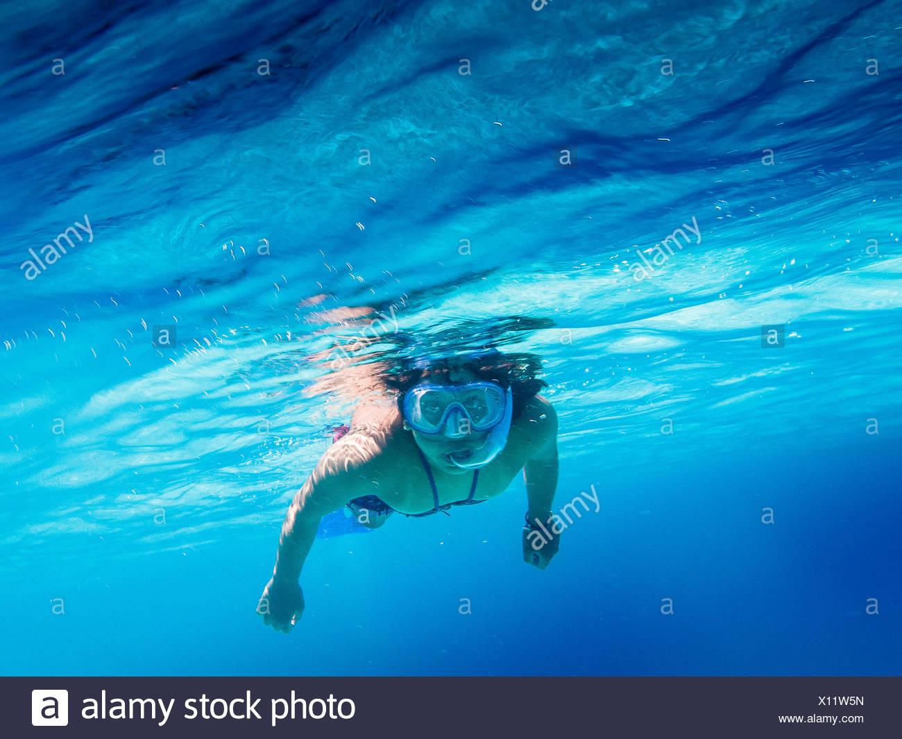 Portrait of Woman swimming in Blue Sea Photo Stock