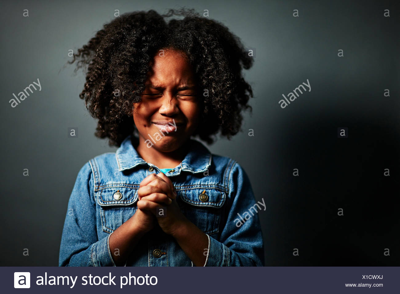 Afro Girl with hands clasped Photo Stock