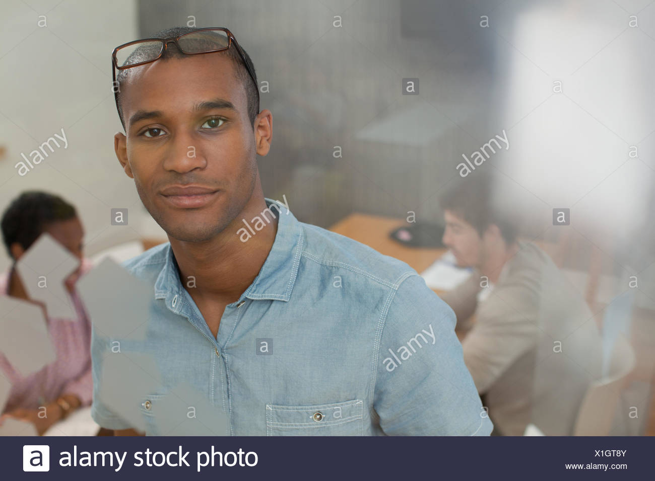 Portrait confident businessman in conference room Photo Stock