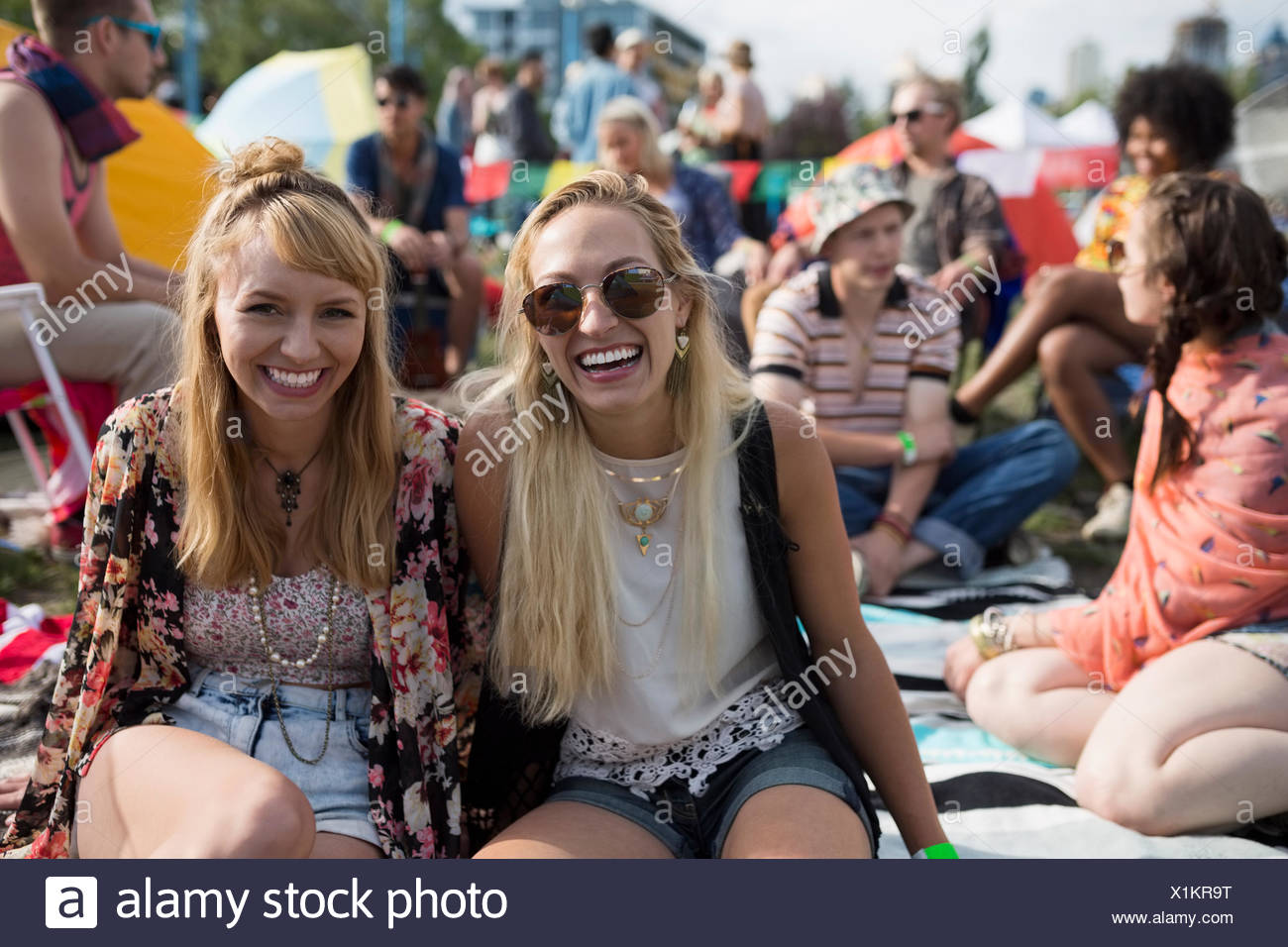 Portrait smiling young women at summer music festival camping Photo Stock