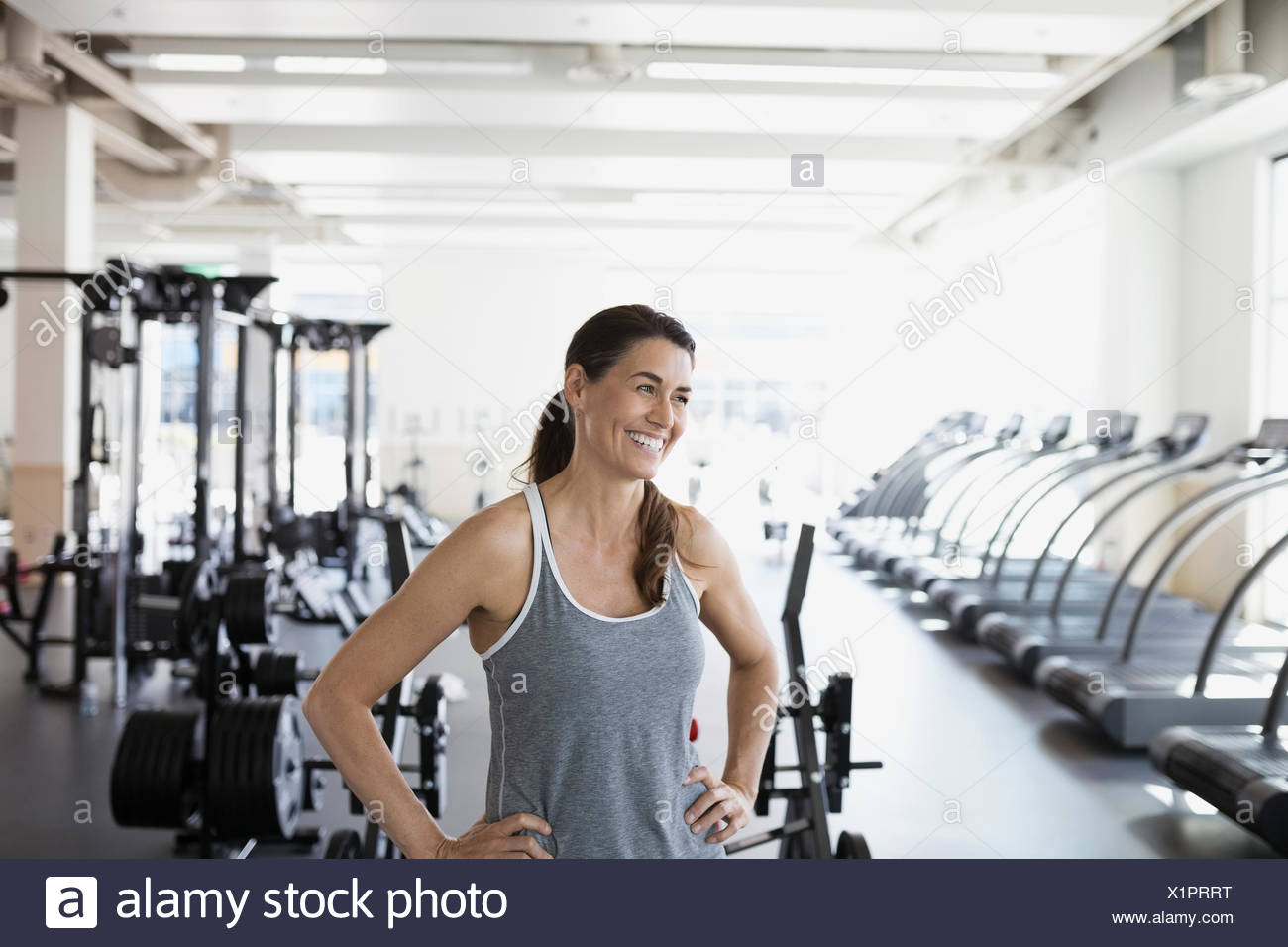 Laughing woman looking at gym Photo Stock