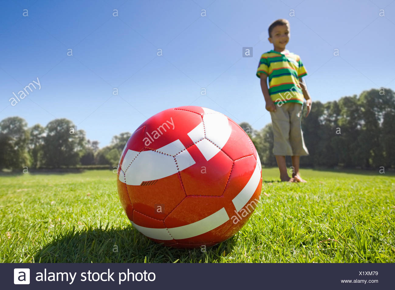 Boy in park with football Photo Stock