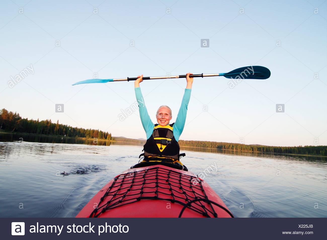 Smiling woman holding paddle Photo Stock