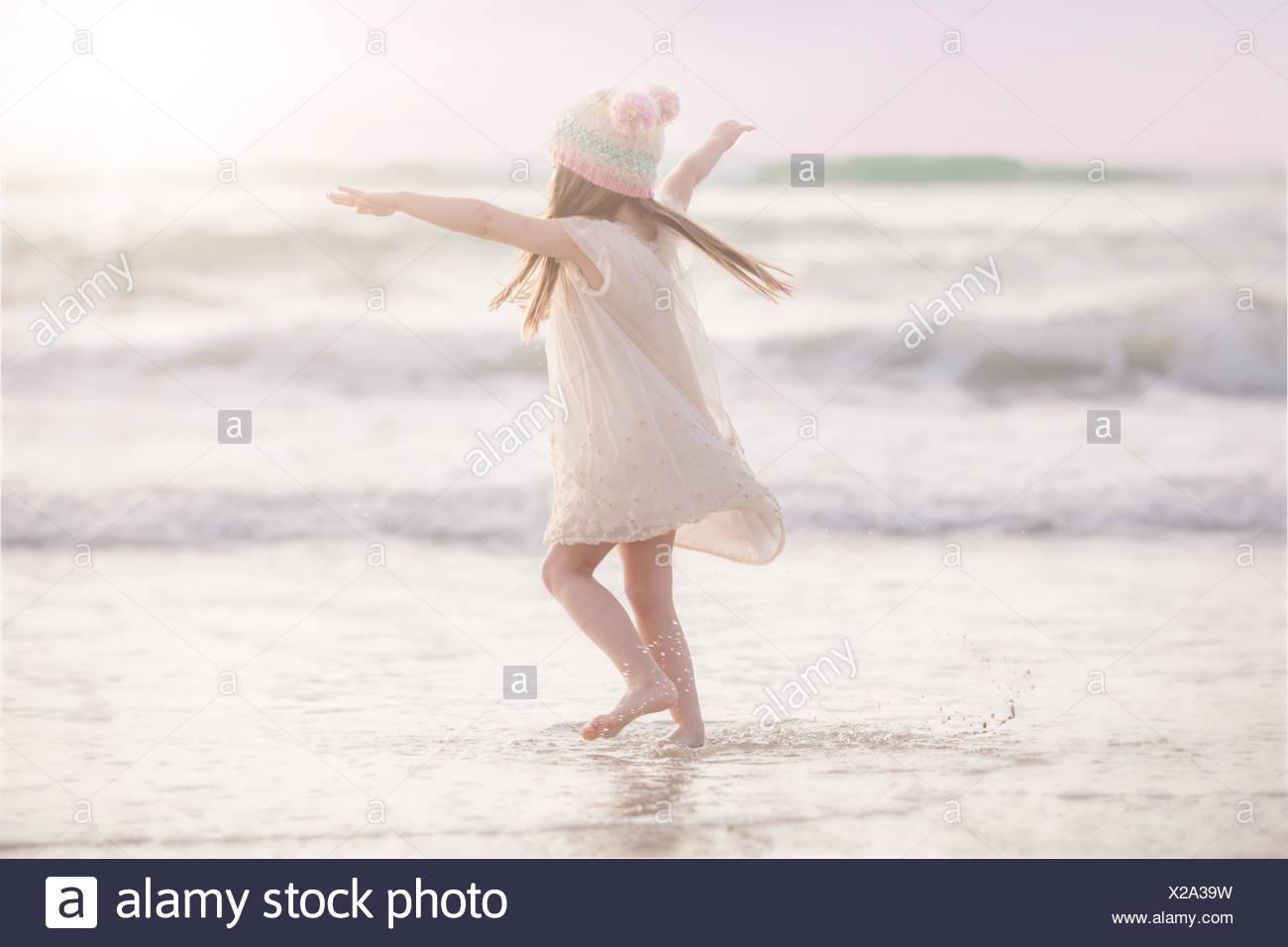 Girl Dancing on the beach Photo Stock