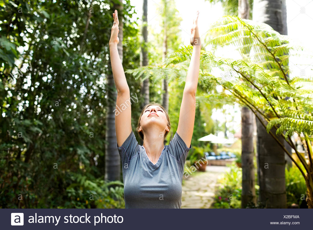 Woman practicing yoga Photo Stock