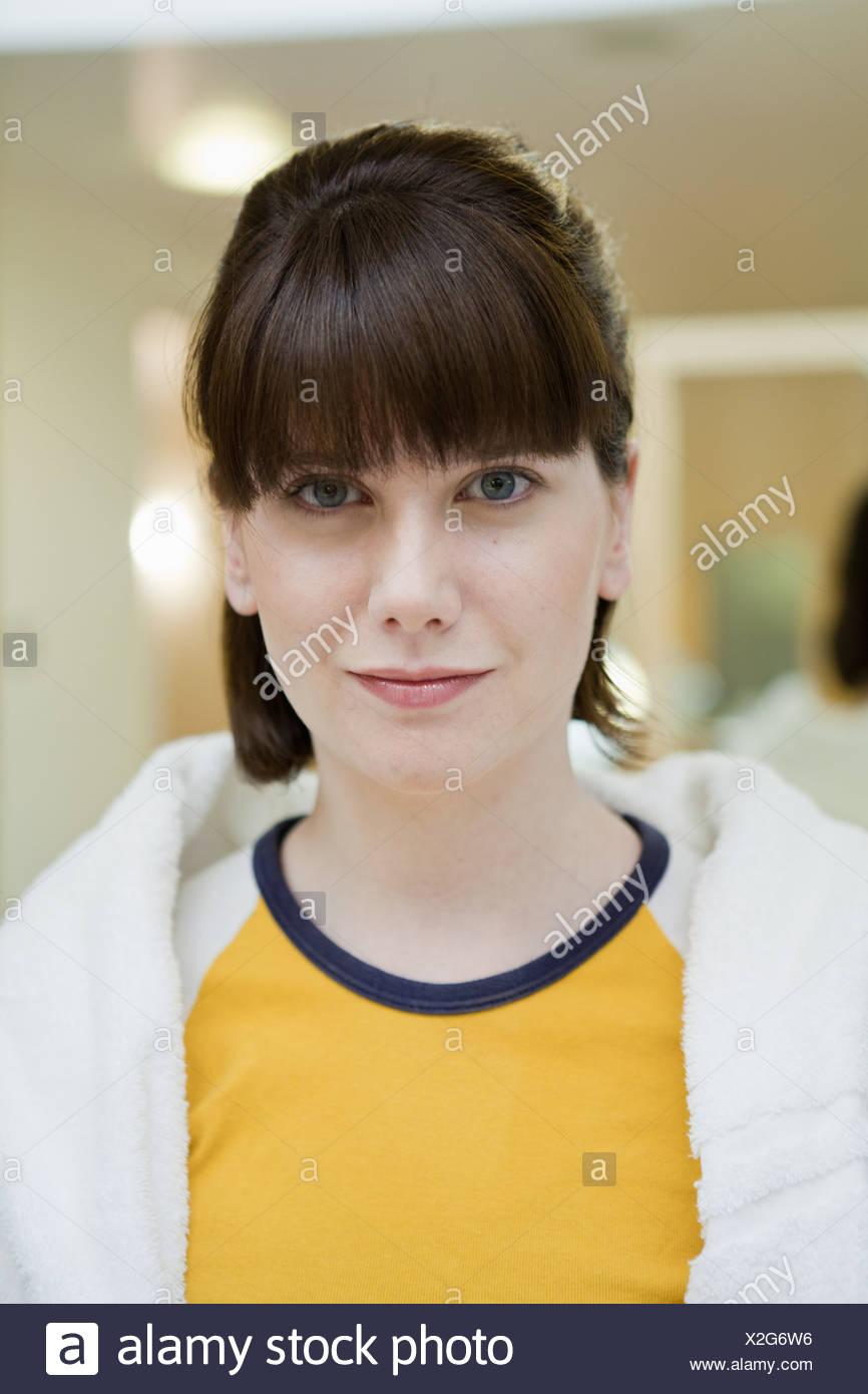 Smiling woman wearing towel around neck Photo Stock
