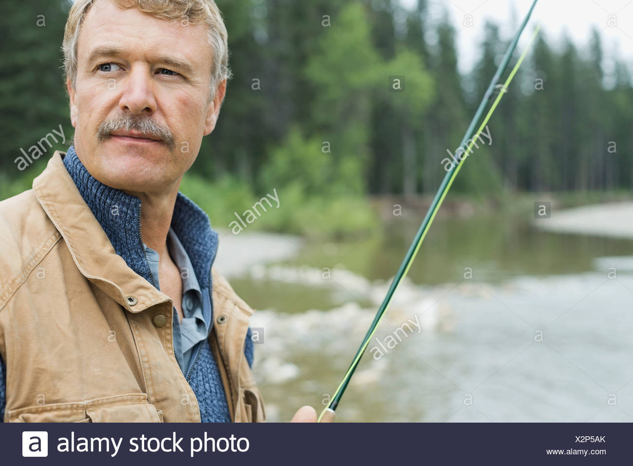 Portrait of mature man fishing Photo Stock