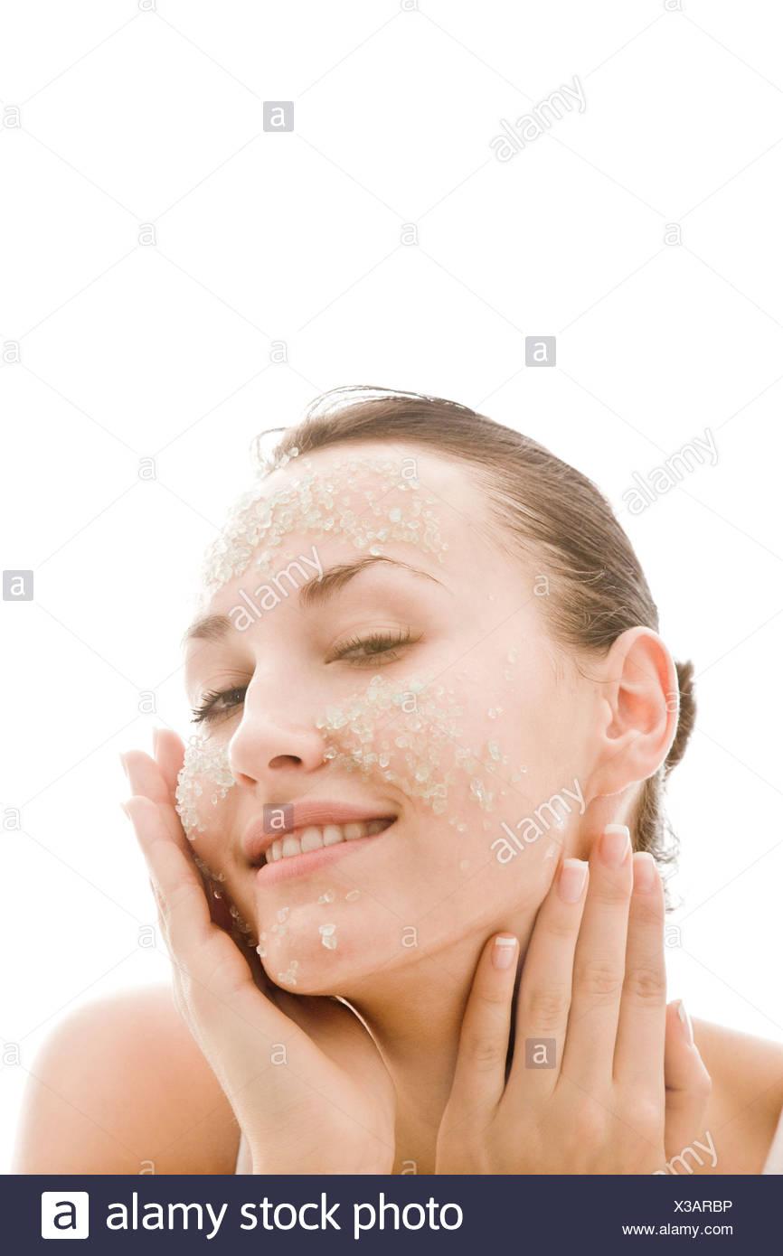 Woman applying facial mask Photo Stock