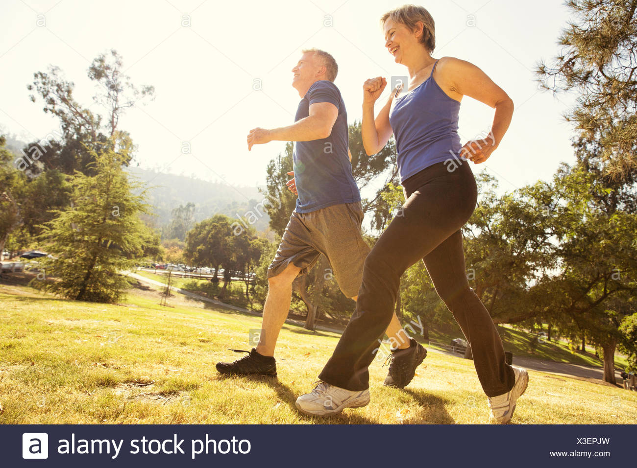 Couple Senior Power walking in park Photo Stock