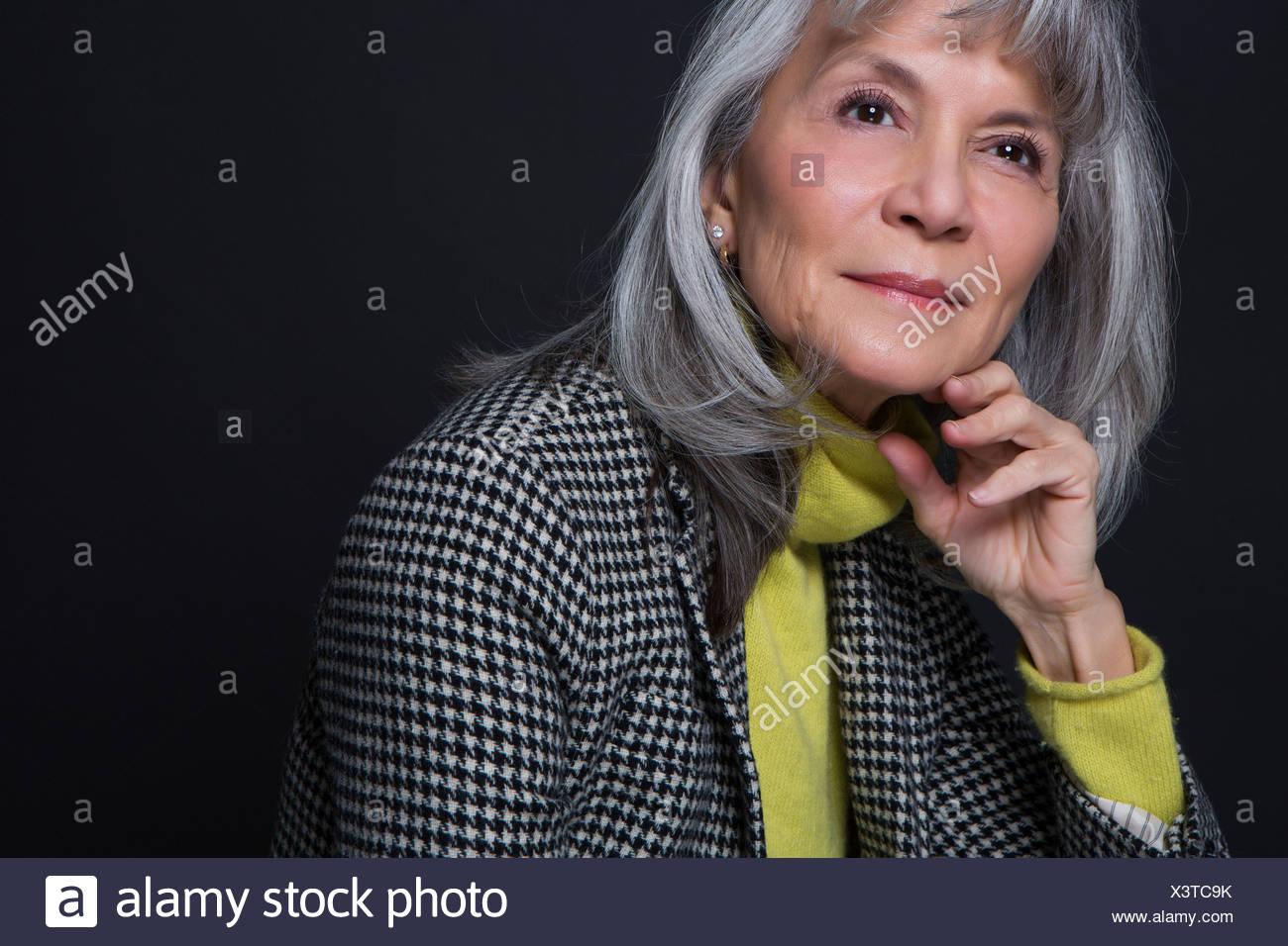 Studio portrait of attractive senior woman Photo Stock
