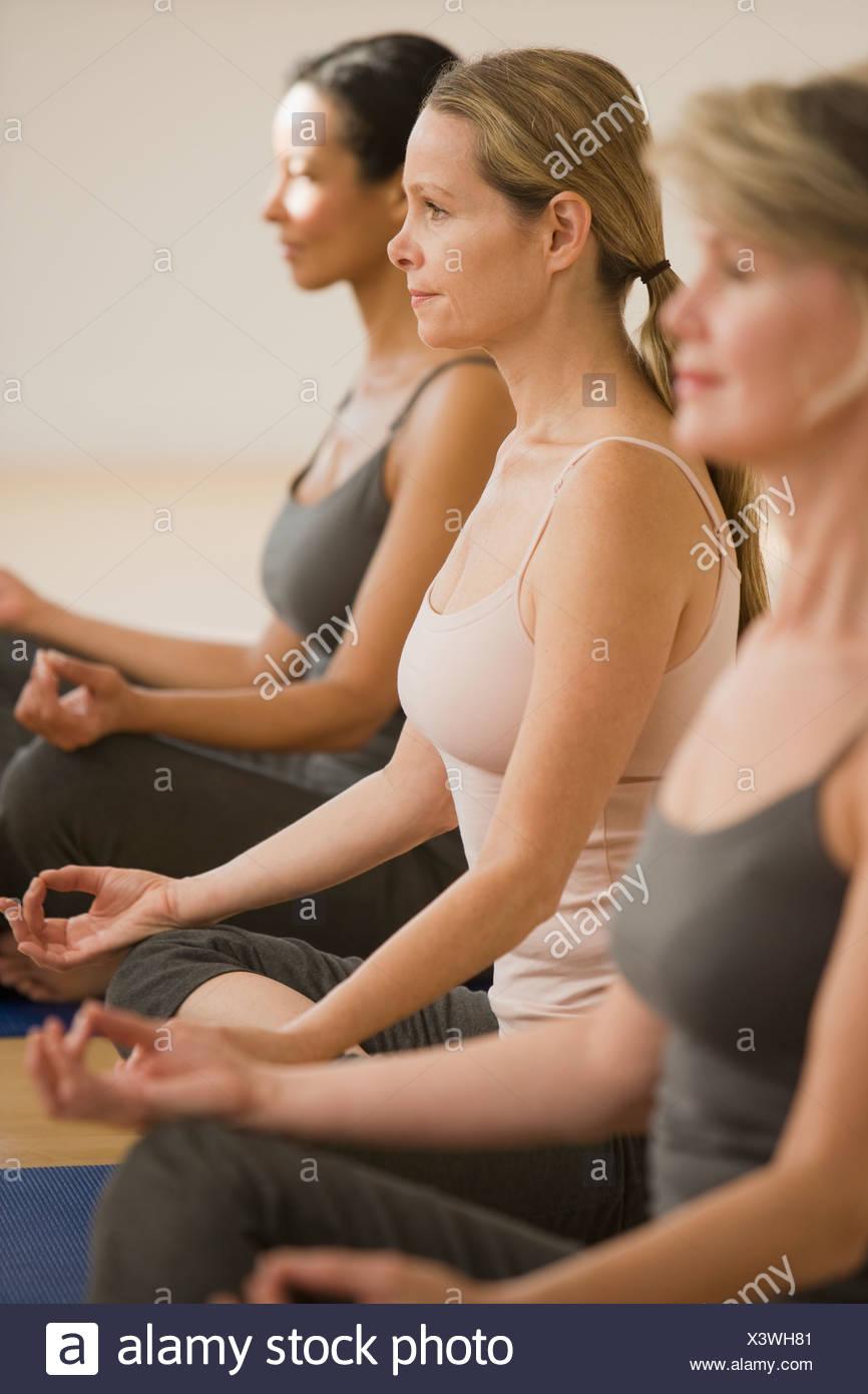 Multi-ethnic women practicing yoga Photo Stock