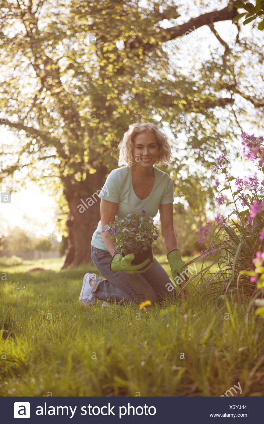 A mature woman in a garden Photo Stock