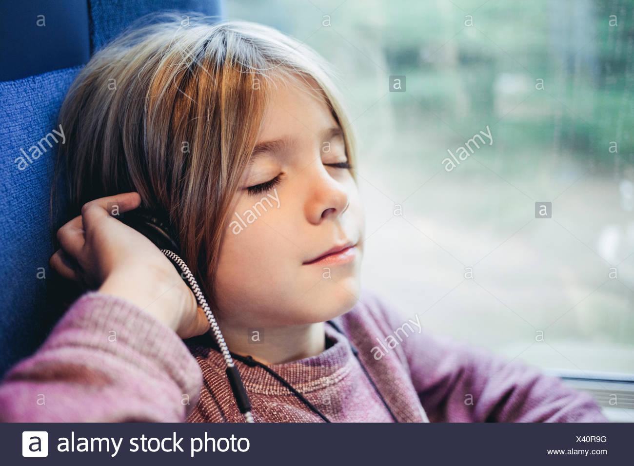 Boy listening to music Photo Stock
