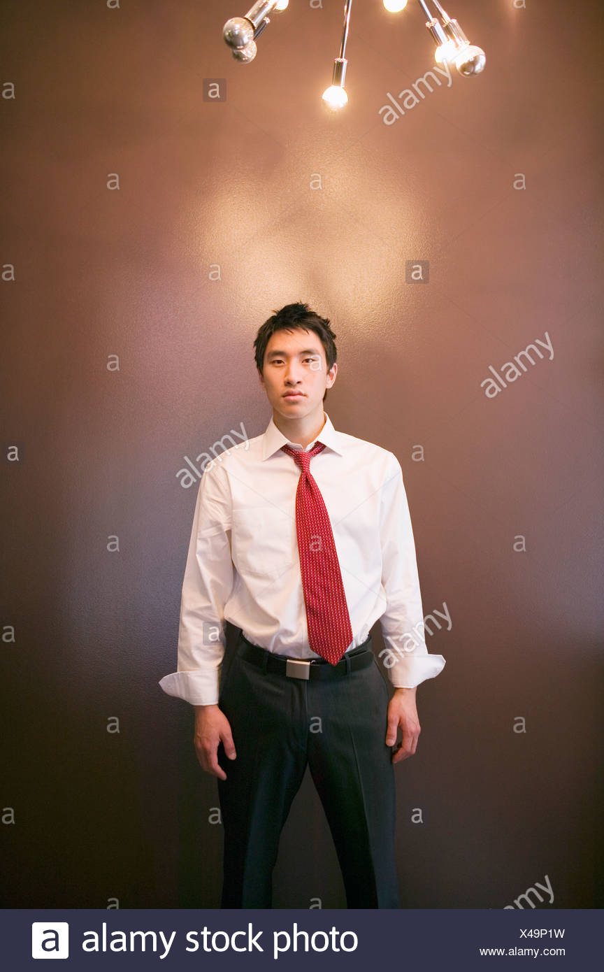 Asian businessman sous l'éclairage Photo Stock