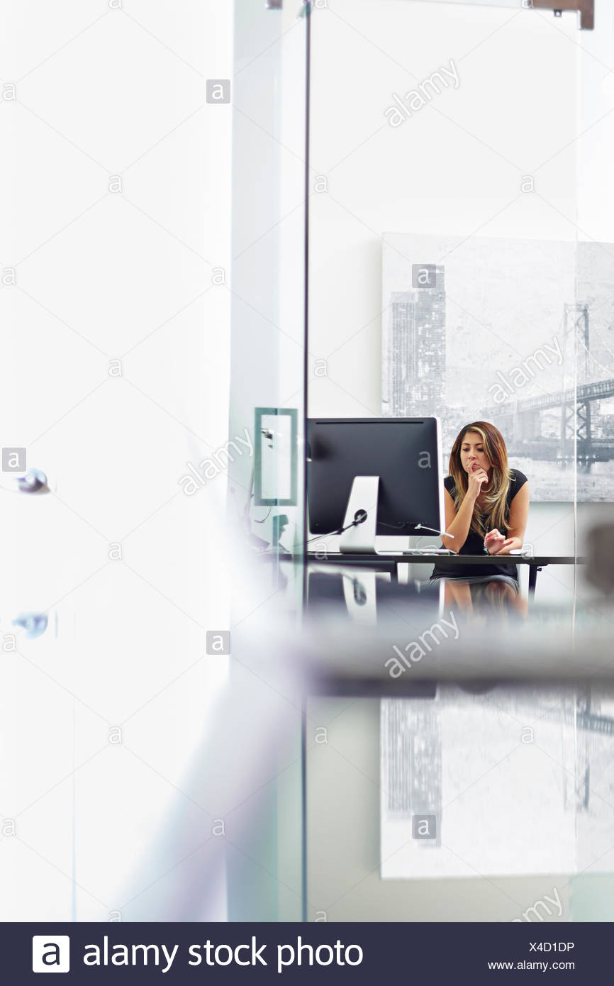 Young woman working in office Photo Stock