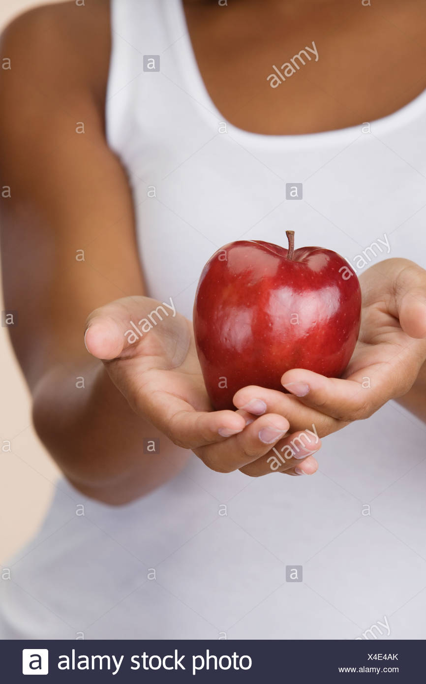 Close up of apple en African woman's hands Photo Stock