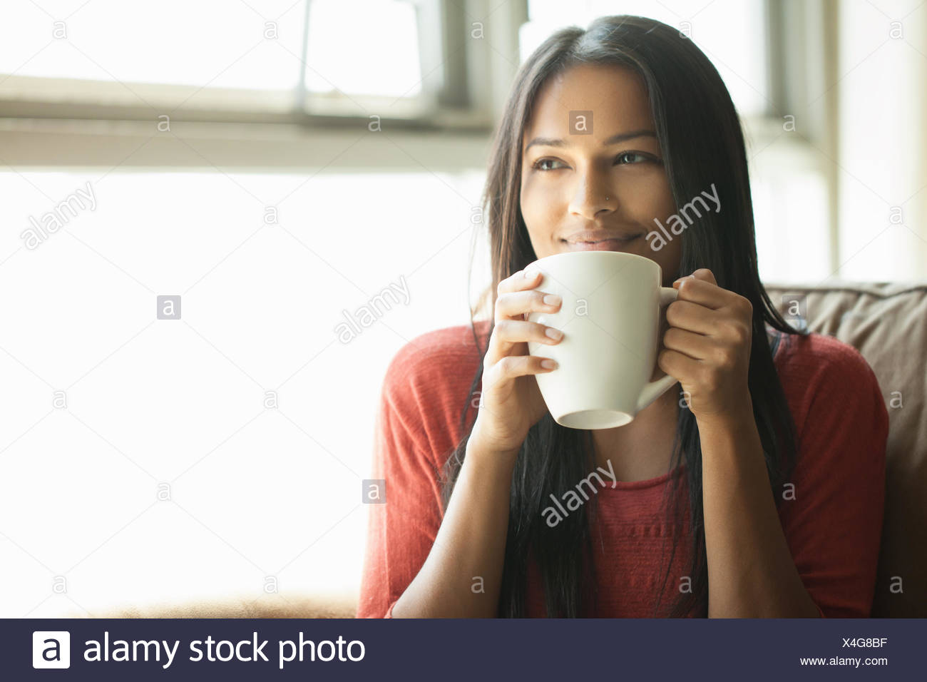 Woman having coffee at home Photo Stock